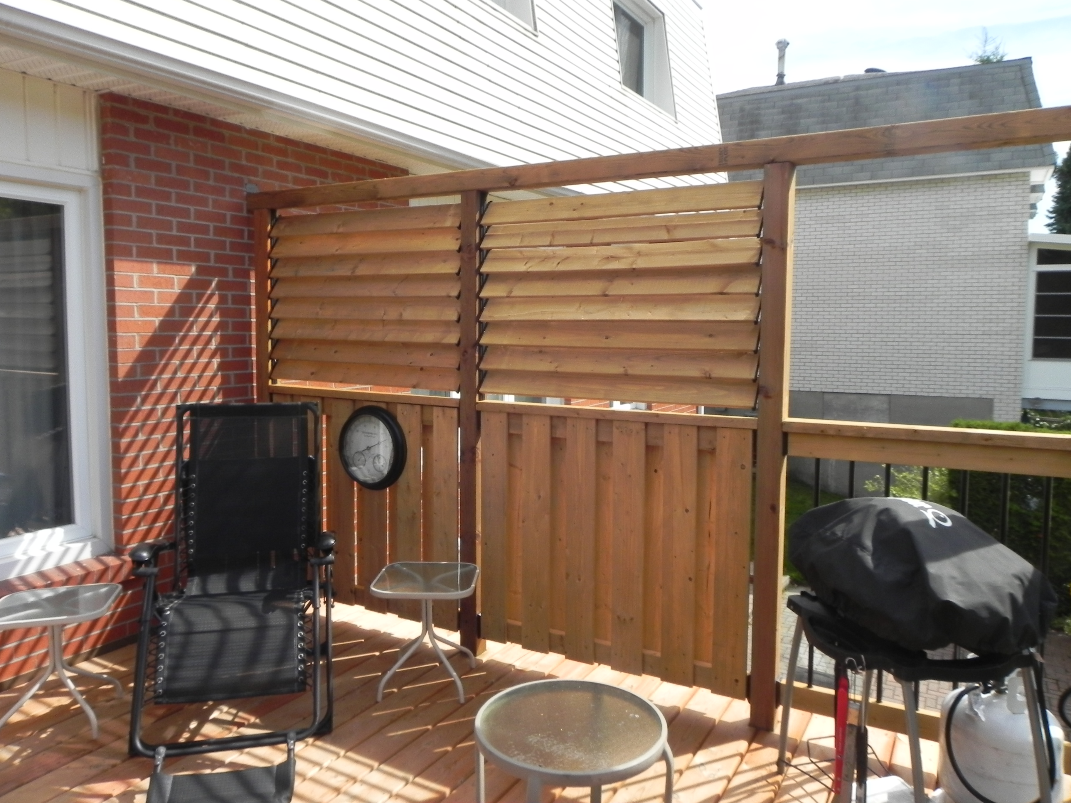 Lively Sunroom Addition Privacy Wall from Deck