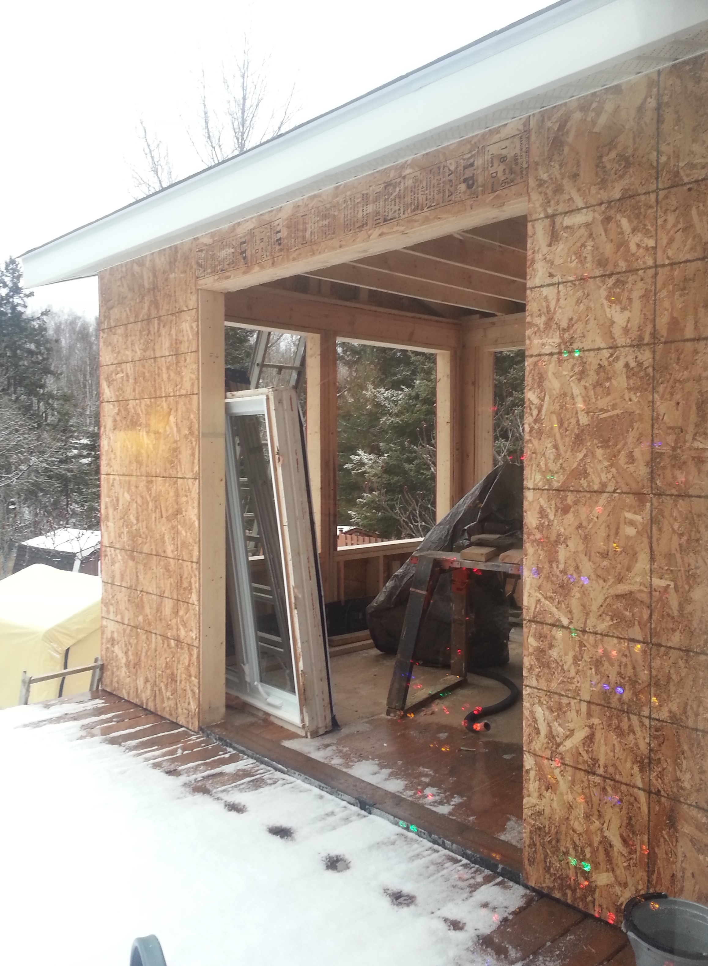 Lively Sunroom Addition Framing Up and Sheathed
